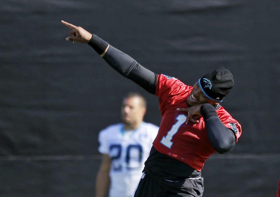 Carolina Panthers quarterback Cam Newton jokes with teammates during practice on Friday. Photo: Marcio Jose Sanchez — The Associated Press   / AP