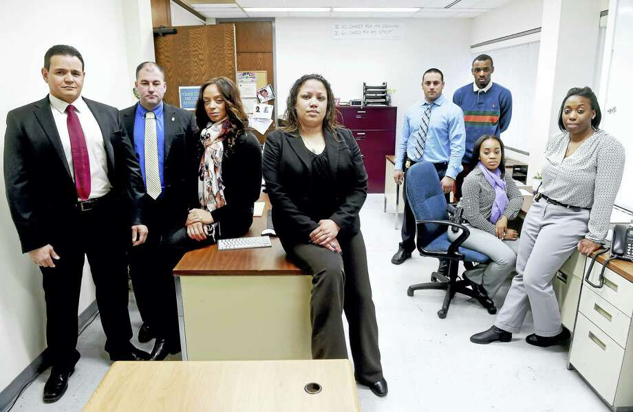 The Special Victims Unit of the New Haven Police Department. Left to right are Detective Juan Ingles, Detective Joe Landisio, Detective Shayna Kendall, Sgt. Betsy Segui, Detective Matt Abbate, intern Robert Durant III, Officer Cherelle Carr and Detective Dana Martin. Photo: Arnold Gold — New Haven Register