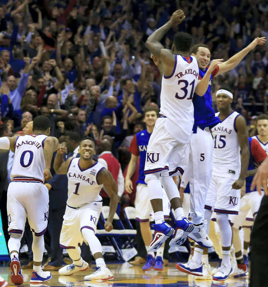 Kansas' Jamari Traylor (31) and Evan Manning leap into the air as Frank Mason III (0) and Wayne Selden Jr. (1) celebrate following their win over Oklahoma last week. Photo: The Associated Press   / AP