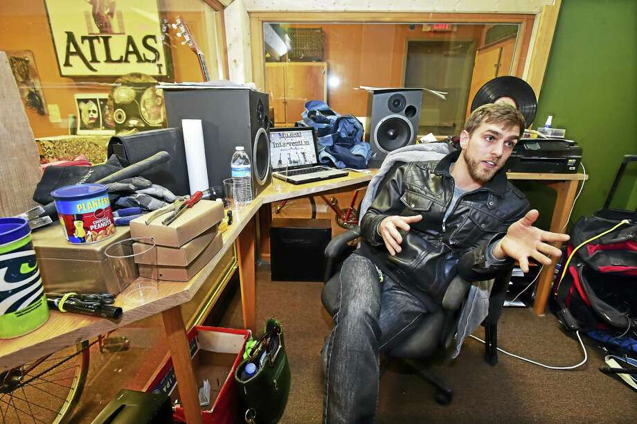 East Haven resident Adam Christoferson, founder and CEO of Musical Intervention LLC is photographed in his recording studio at 23 Temple St. in New Haven on opening night, Saturday, April 2, 2016. Christoferson proposed his plan to offer music lessons, songwriting workshops and mobile recording services to the city's vulnerable population to the Department of Arts, Culture and Tourism's Project Storefronts, a program where local artists use vacant retail space to gain public exposure. Photo: Catherine Avalone — New Haven Register    / New Haven RegisterThe Middletown Press
