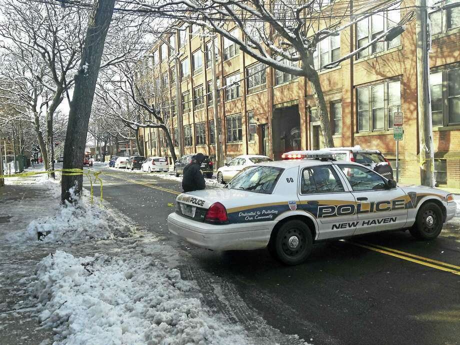 A New Haven police vehicle blocks the street at the intersection of Olive and Court streets while state police investigate the fatal crash Saturday morning. Photo: JULIEMAR ORTIZ — NEW HAVEN REGISTER