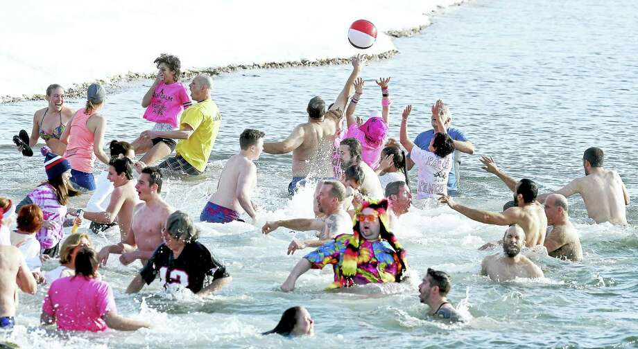 A beach ball is tossed Saturday morning (02/06/16) between participants in the frigid waters at Savin Rock in West Haven at the 16th Annual Icy Plunge for the Cure, organized by the West Haven Breast Cancer Awareness Committee. Photo: Arnold Gold — New Haven Register