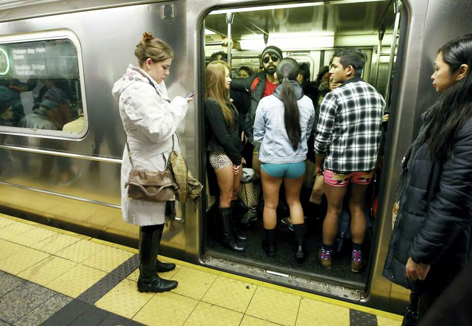 The doors of a subway train open revealing pantless riders in colorful underwear during the 15th annual No Pants Subway Ride Sunday in New York. The group event has been going on since 2002. Photo: Associated Press   / AP