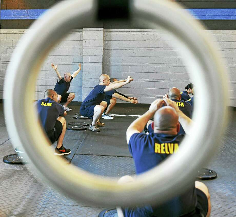 New Haven Police Academy recruits perform physical exercise during a CrossFit pilot program specifically created for police training a the New Haven Police Academy gym at 200 Wintergreen Ave., New Haven. Photo: (Peter Hvizdak - New Haven Register)   / ©2016 Peter Hvizdak