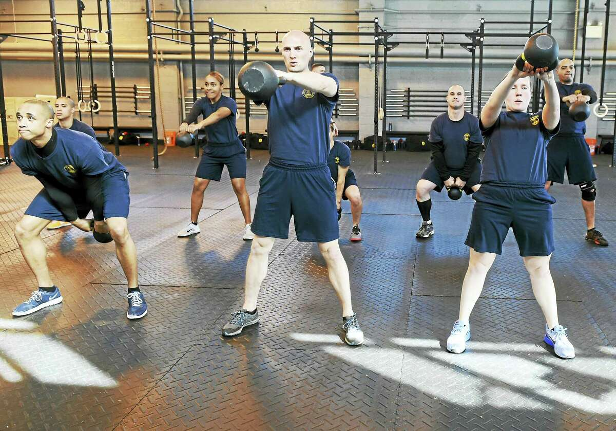 New Haven Police Academy recruits perform kettlebell workout during a CrossFit pilot program specifically created for police training a the New Haven Police Academy gym at 200 Wintergreen Ave., New Haven.