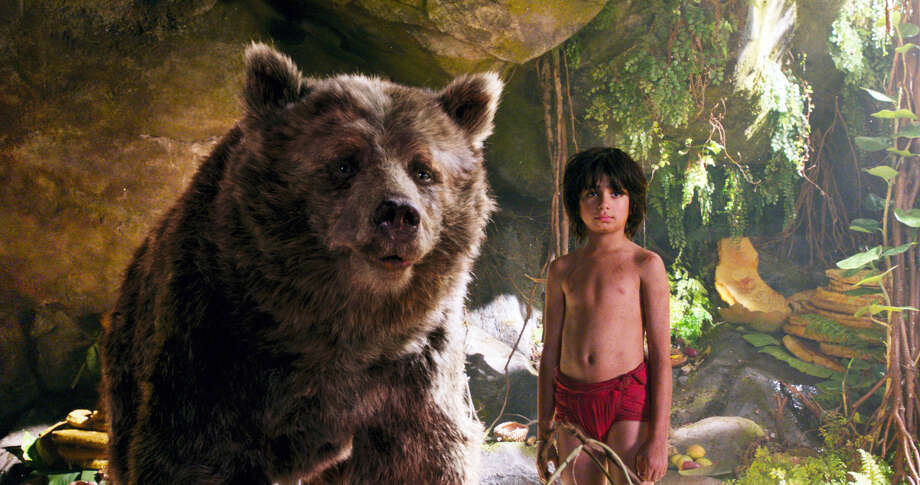 """In this image released by Disney, Mowgli, portrayed by Neel Sethi, right, and Baloo the bear, voiced by Bill Murray, appear in a scene from, """"The Jungle Book."""" Photo: Disney Via AP   / Disney"""
