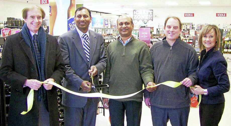 EMPIRE OPENS: From left, Wallingford Mayor William Dickinson; owner Prasad Maganti and his brother, Ram Maganti; manager Jim Morrison; and Quinnipiac Chamber of Commerce Executive Director Dee Prior-Nesti celebrate the grand opening ribbon-cutting for Empire Wine & Liquor, 1145 N. Colony Road in Wallingford. The newly renovated location sells alcohol at state minimum prices, according to a release, and offers a selection of craft beer and as high-end wine. Every Friday, the store will offer a free red and white wine tasting, the release said. Photo: CONTRIBUTED PHOTO