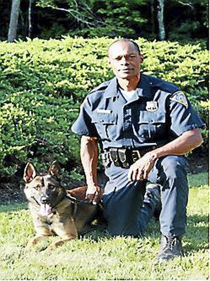 New Haven police Officer Joseph Roberts with Zo Photo: (Contributed Photo)