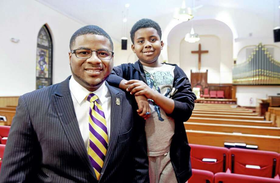 Youth Minister Quavon Newton, left and his son, Qamari, 9, at Varick Memorial AME ZIon Church in New Haven. Photo: Arnold Gold — New Haven Register