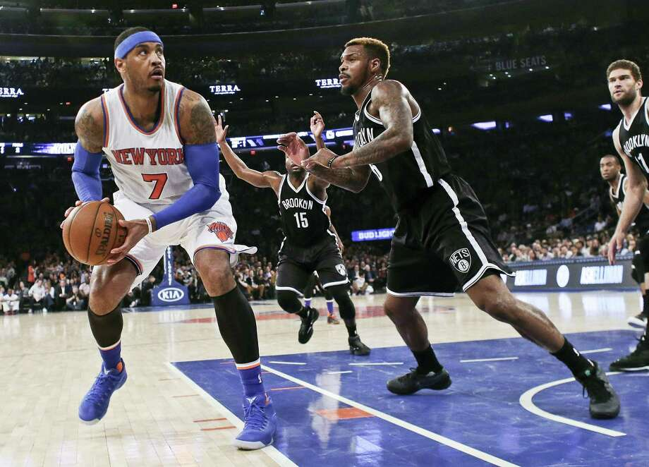 The Knicks' Carmelo Anthony (7) looks for a shot as the Nets' Sean Kilpatrick defends during the first half on Friday. Photo: Frank Franklin II — The Associated Press   / Copyright 2016 The Associated Press. All rights reserved. This material may not be published, broadcast, rewritten or redistributed without permission.