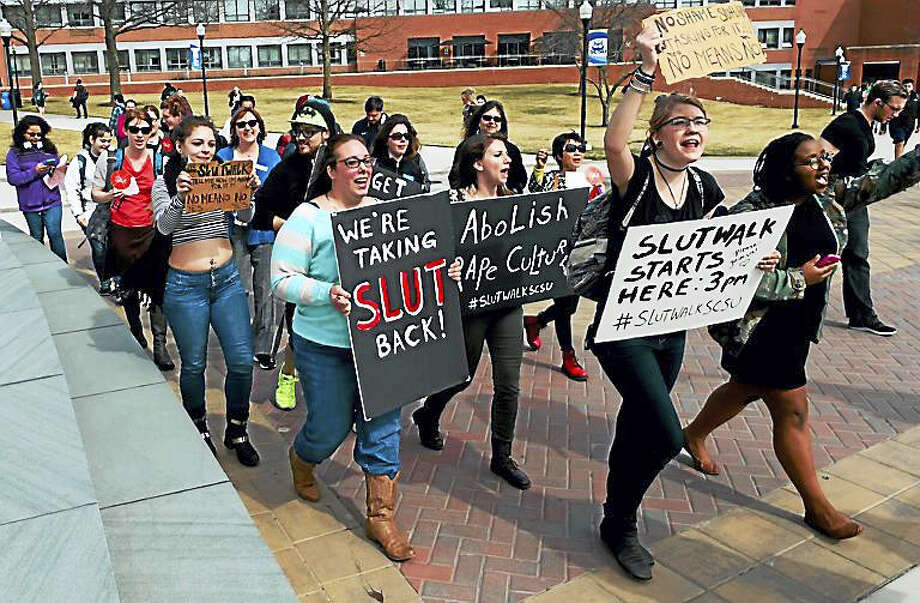 Dozens of students marched Thursday at Southern Connecticut State University in New Haven in a one-mile SlutWalk. The march was part of an international event that protests the stigma gender violence and sexual assault. Photo: Peter Hvizdak — New Haven Register