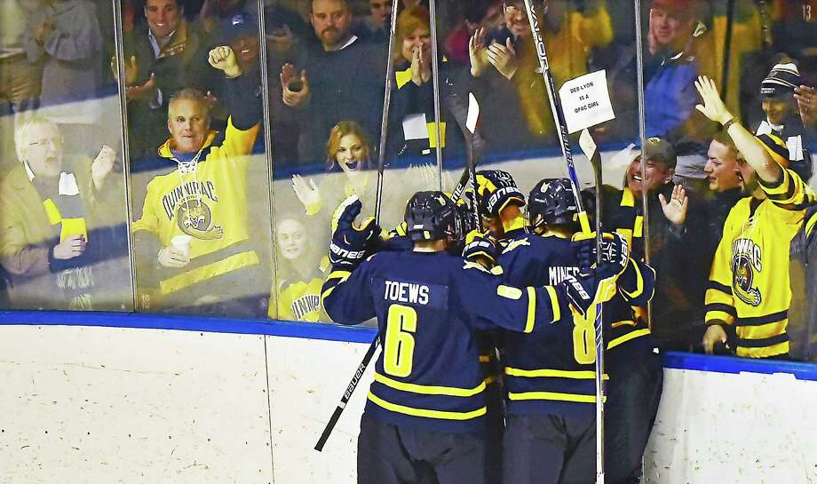 The Quinnipiac Bobcats celebrate their second goal against Yale defeating the Bulldogs, 3-0, in an Eastern College Athletic Conference game, Tuesday, December 4, 2015 at Ingalls Rink. (Catherine Avalone/New Haven Register) Photo: Journal Register Co. / New Haven RegisterThe Middletown Press