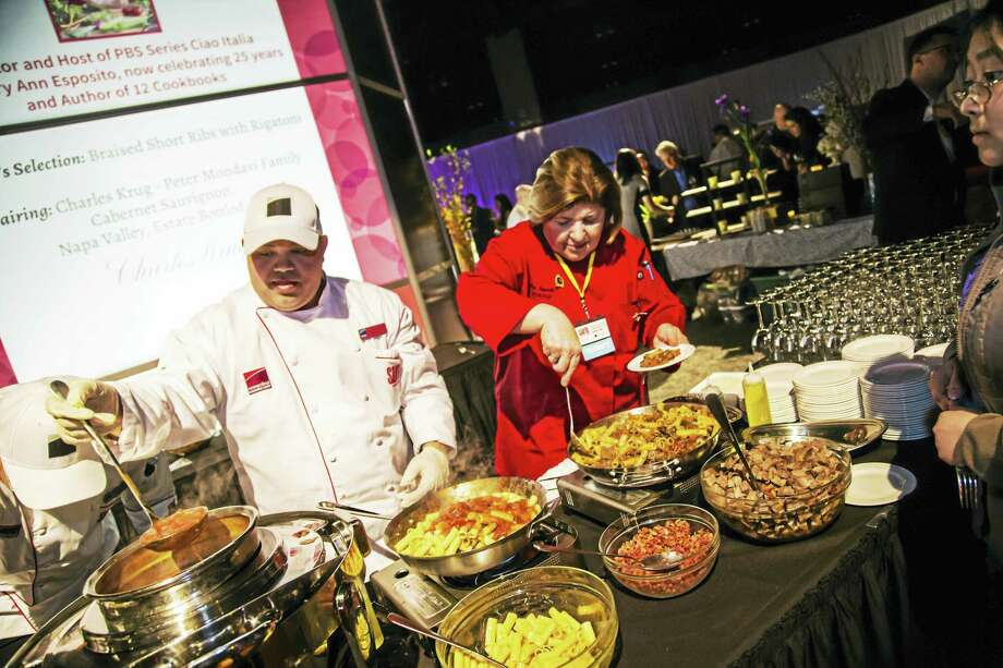 TV chef Mary Ann Esposito, right, prepares food at last year's event. Photo: Photo Courtesy Of Savor