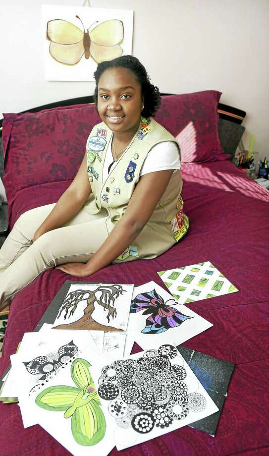 (Arnold Gold-New Haven Register)  Jenelle Grant, 17, of Milford Girl Scout Troop 38369 is photographed at her home in Milford with some of her artwork on 1/3/2016. Photo: Journal Register Co.
