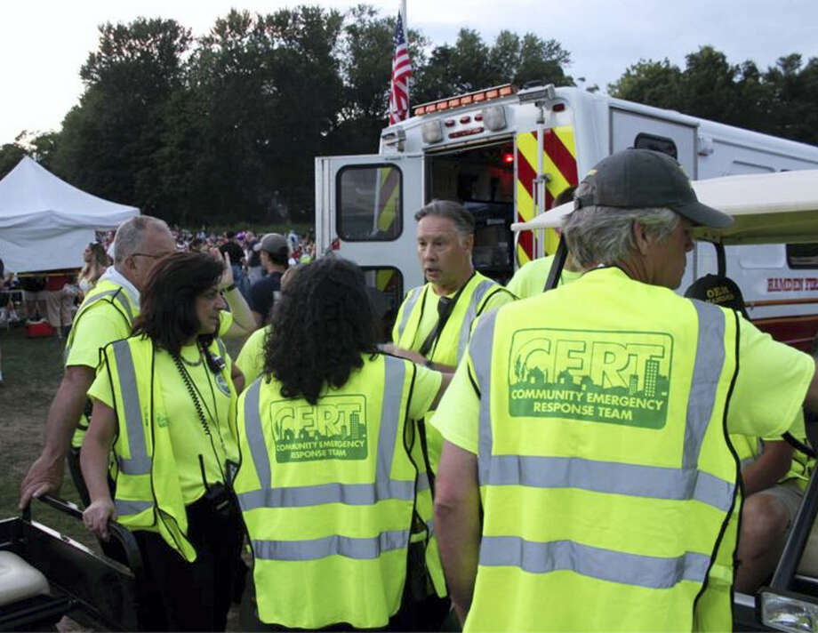 Hamden CERT Director Bob Freeman consults with CERT members during one of last summer's concerts at Town Center Park.Contributed photo Photo: Journal Register Co.