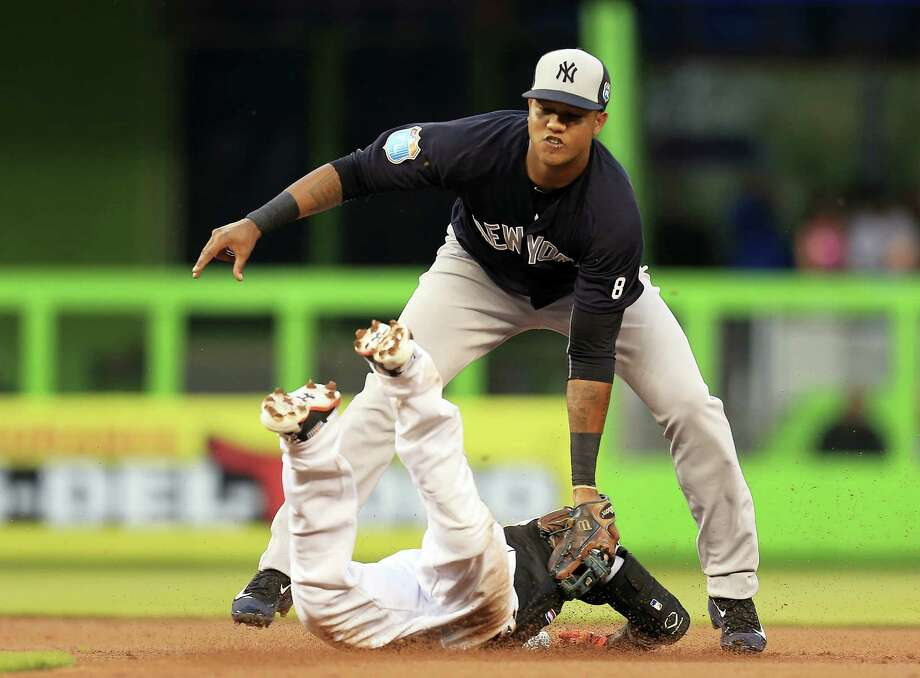 A dispute between YES Network and Comcast may prevent some New York Yankees fans from watching shortstop Starlin Castro and his teammates on TV this season. Photo: THE ASSOCIATED PRESS   / FR171438 AP