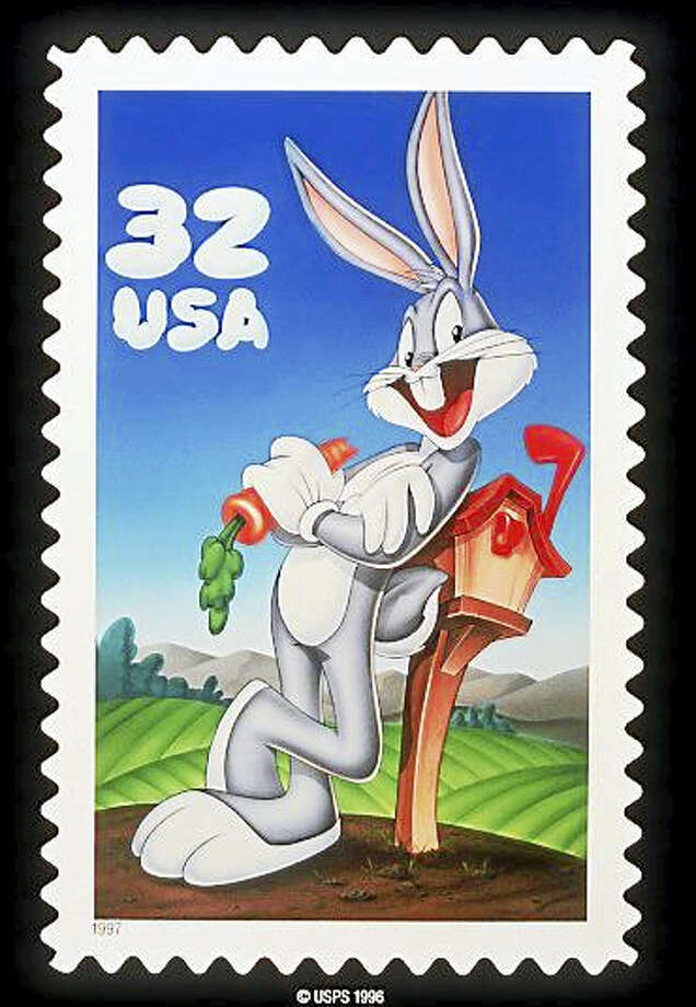 """What's Up Doc?"" The United States Postal Service dedicated its Bugs Bunny stamp on the Warner Bros. lot in Burbank, Calif., on May 22, 1997. Bugs Bunny was the first animated character to appear on a U.S. postage stamp. On Wednesday, Feb. 3, 2016, one of the men to voice Bugs Bunny died of cancer. Photo: AP Photo/U.S. Postal Service"