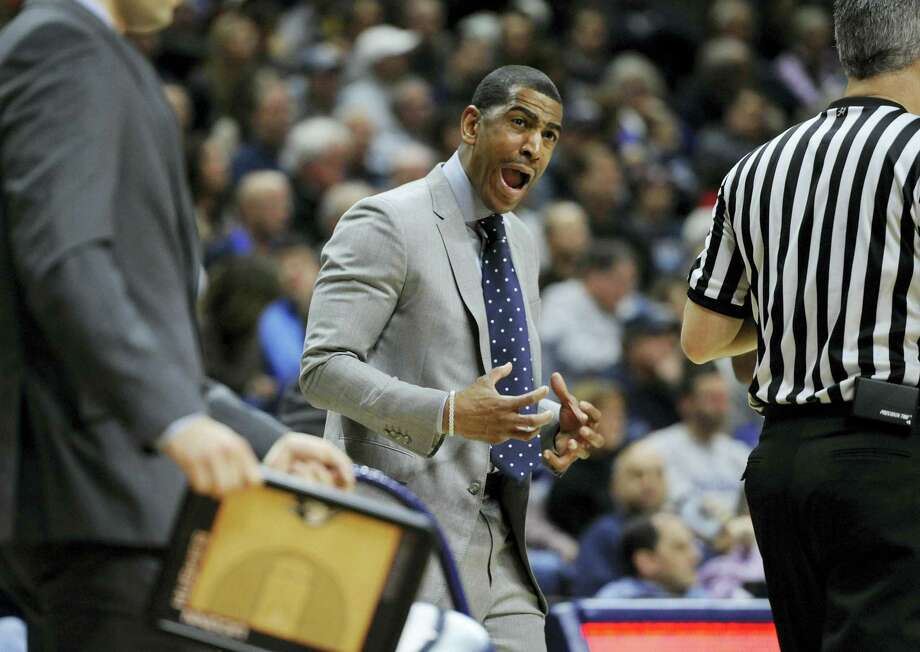 UConn head coach Kevin Ollie reacts in the first half of Saturday's game against Memphis. Photo: Jessica Hill — The Associated Press   / FR125654 AP