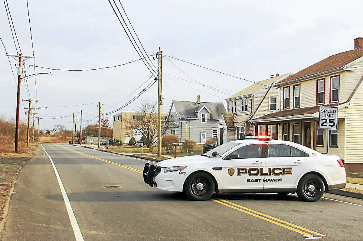 An East Haven police cruiser blocks off a portion of South End road in East Haven Friday.