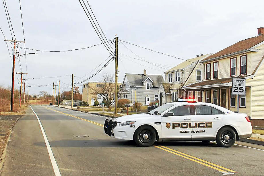 An East Haven police cruiser blocks off a portion of South End road in East Haven Friday. Photo: Esteban L. Hernandez — New Haven Register