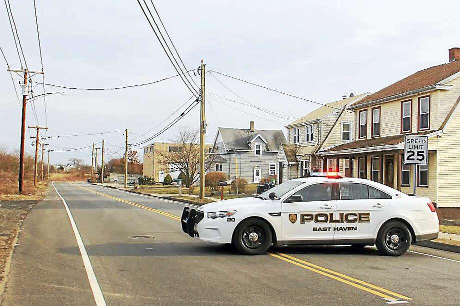 An East Haven police cruiser blocks off a portion of South End road in East Haven Friday. Photo: Esteban L. Hernandez — New Haven Register