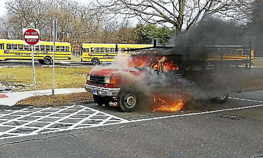 Firefighters extinguished a truck fire in front of Shepard Glen School in Hamden Friday. Photo: PHOTO COURTESY OF THE HAMDEN FIRE DEPARTMENT