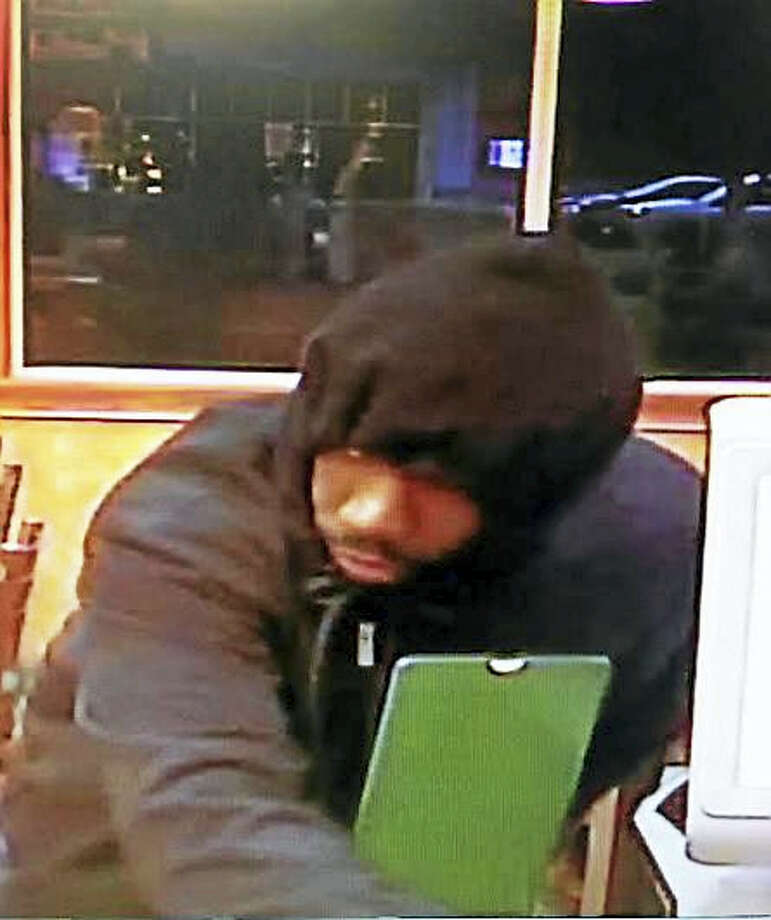 Shelton police are asking for the public's help to identify this man who they say was involved in recent robbery. Photo: Photo Courtesy Of The Shelton Police Department