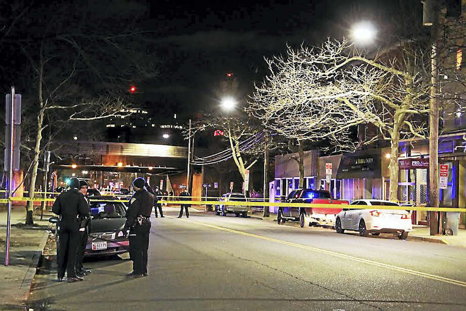 New Haven police investigate a shooting after a victim was found on State Street Friday night. Photo: Esteban L. Hernandez — New Haven Register