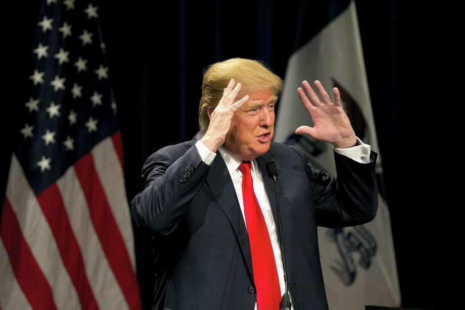 Republican presidential candidate Donald Trump gestures while speaking at a rally, Saturday, Jan. 9, 2016, in Ottumwa, Iowa. Photo: AP Photo/Jae C. Hong / AP