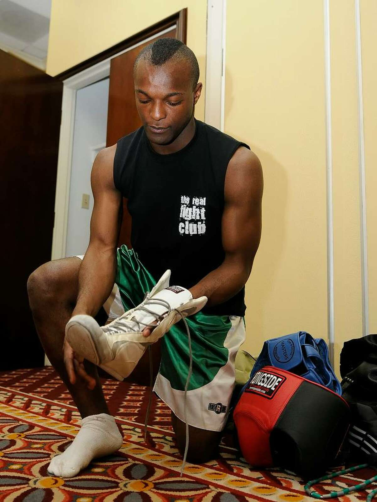 Sorba Brima, Stamford, gets ready for his amateur boxing match for later in the evening. By day Brima is an operations analyst for an electricity supplier, and has been training at Revolution Fitness since February. The amateur boxers are part of a charity event called the