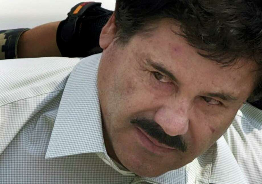 "FILE - In this Feb. 22, 2014 file photo, Joaquin ""El Chapo"" Guzman is escorted to a helicopter in handcuffs by Mexican Navy marines at a navy hanger in Mexico City. Mexican President Enrique Pena Nieto posted on his Twitter account, Friday, Jan. 8, 2016, that drug lord Joaquin 'Chapo' Guzman has been recaptured. Photo: AP Photo/Eduardo Verdugo, File / AP"