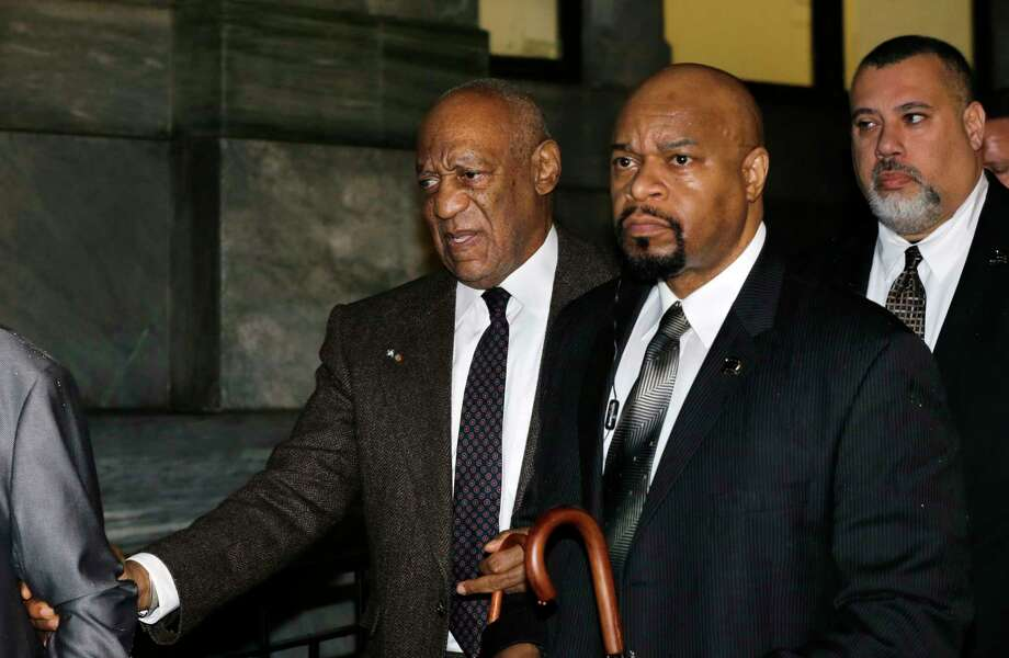 Actor and comedian Bill Cosby, left, is assisted as he leaves after a court appearance Wednesday, Feb. 3, 2016, in Norristown, Pa. Common Pleas Judge Steven O'Neill refused to throw out the sexual assault case against Cosby on Wednesday, sweeping aside a former district attorney's claim that he granted the comedian immunity from prosecution a decade ago. O'Neill issued the ruling after a hard-fought two-day hearing, saying witness credibility was a factor. He did not elaborate. Photo: AP Photo/Mel Evans    / AP