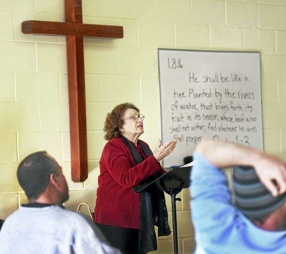 Marie Biondi, a volunteer at The 180 Center at 793 Grand Ave. in New Haven, teaches a Bible study there Friday. Photo: Peter Hvizdak — New Haven Register   / ?2016 Peter Hvizdak