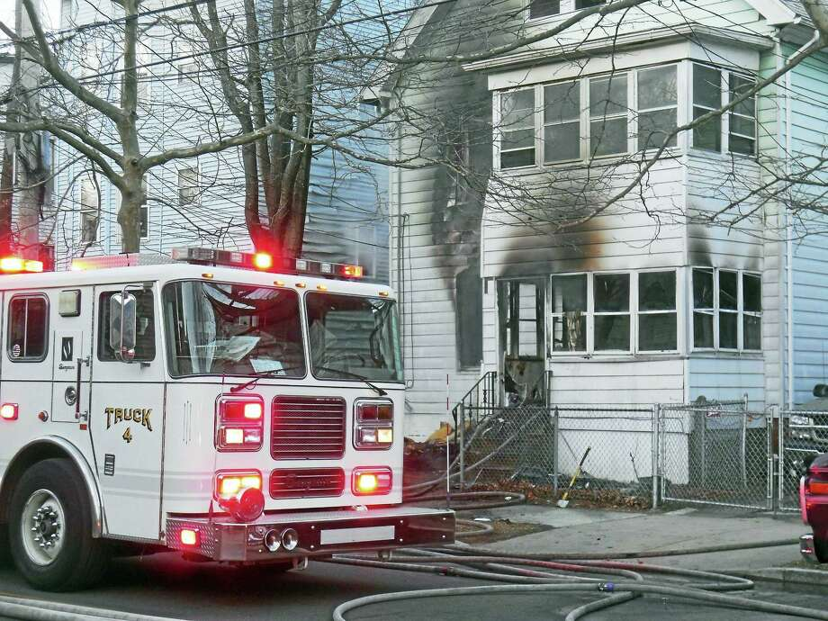 Six children and two adults were displaced after a fire broke out early Thursday at 704 Winchester Ave. in New Haven. There were no reports of injuries. Photo: Wes Duplantier — New Haven Register
