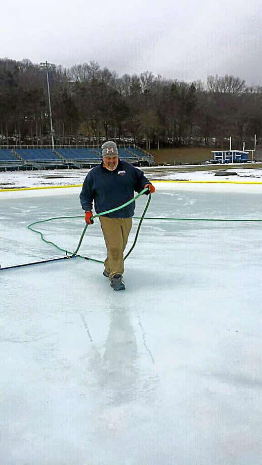 Sean Rowley, a foreman with Ansonia's Recreation Department, helps ice things up. Photo: Contributed Photo