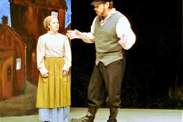 """Chava, played by Adrienne Camm, and her father, Tevye, played by Thomas Camm, discuss her relationship with a young Russian man, Fyedka, in a scene from """"Fiddler on the Roof"""" at The Gary The Olivia Theater in Bethlehem Saturday, July 29, through Sunday, Aug. 20."""