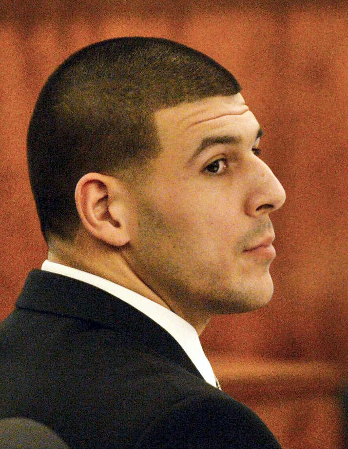 Former New England Patriots football player Aaron Hernandez listens to testimony during his murder trial, Friday, Jan. 30, 2015, in Fall River, Mass. Hernandez is charged with killing semiprofessional football player Odin Lloyd, 27, in June 2013. Photo: AP Photo/The Boston Herald, Ted Fitzgerald, Pool    / Pool The Boston Herald