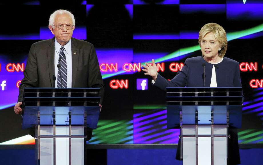 John Locher — The Associated Press  Former Secretary of State Hillary Rodham Clinton, right, speaks as Sen. Bernie Sanders of Vermont looks on during the CNN Democratic presidential debate Oct. 13, 2015, in Las Vegas. Photo: AP / AP
