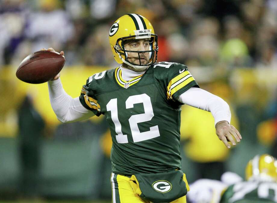 The Register's Dan Nowak is banking on the road teams to deliver in this weekend's NFL wild-card round games. That includes quarterback Aaron Rodgers and the Packers on Sunday against in Washington. Photo: The Associated Press File Photo   / FR155580 AP