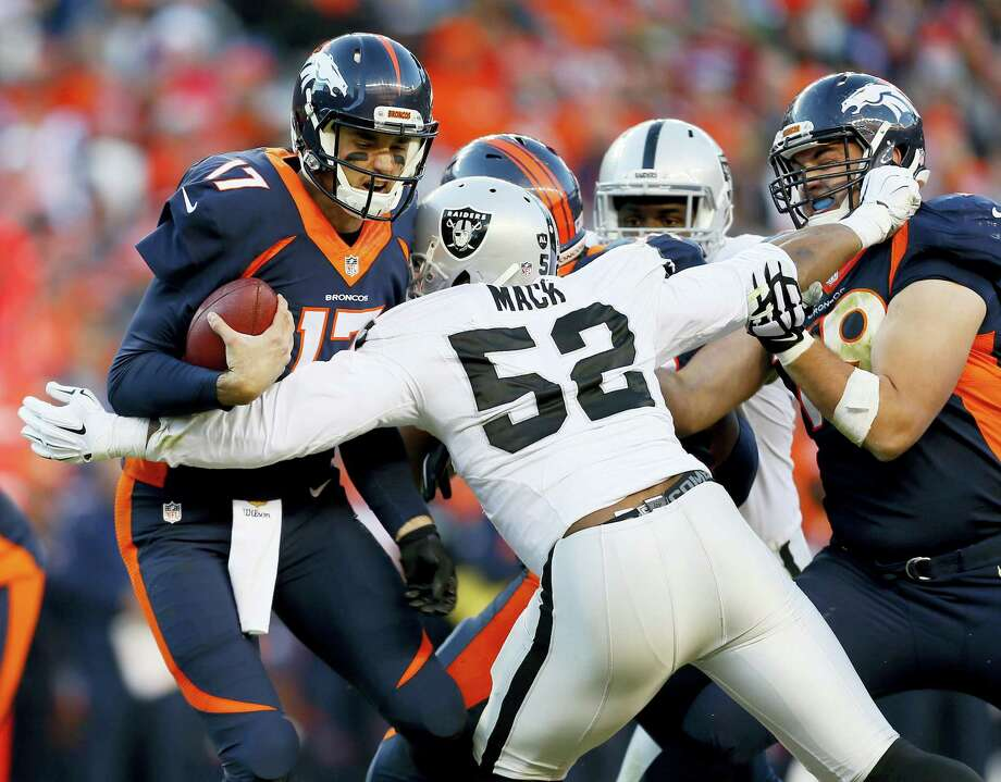 FILE - In this Dec. 13, 2015, file photo, Denver Broncos quarterback Brock Osweiler (17) is sacked by Oakland Raiders defensive end Khalil Mack (52) during the second half of an NFL football game, in Denver. Khalil Mack has become the first selection at two positions in the same year, while Adrian Peterson and J.J. Watt are unanimous choices for the 2015 Associated Press NFL All-Pro Team.  (AP Photo/Joe Mahoney, File) Photo: AP / FR170458 AP