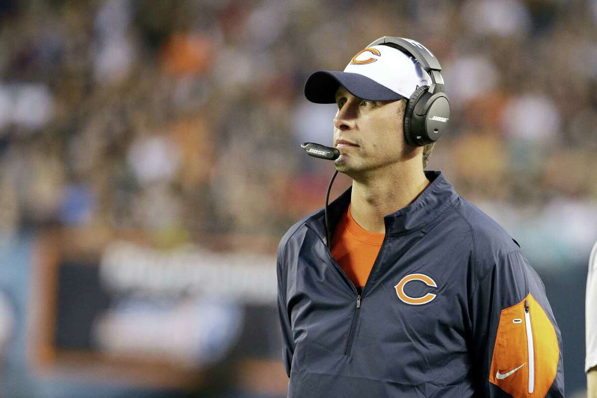 FILE - In this Aug. 13, 2015, file photo, Chicago Bears offensive coordinator Adam Gase during the first half of an NFL preseason football game against the Miami Dolphins in Chicago. Chip Kelly, Gase and Mike Shanahan are just a few of the hot names for teams looking for a new head coach. (AP Photo/Nam Y. Huh, File)