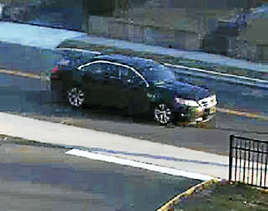 West Haven police are asking for the public's help in finding a man who allegedly robbed the US Alliance Federal Credit Union on Tuesday. The man was last seen entering a dark-colored Ford Taurus Photo: Photo Courtesy Of The West Haven Police Department