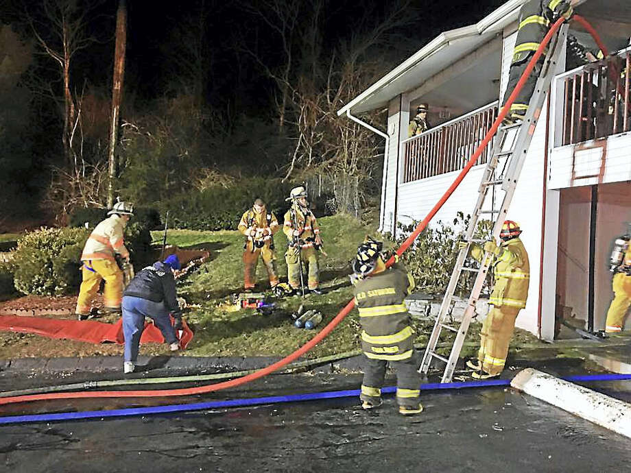 Firefighters from Old Saybrook, Clinton, Essex and Old Lyme battled a two-alarm fire Wednesday night at the Liberty Inn in Old Saybrook. Photo: Photo Courtesy Of The Old Saybrook Fire Department