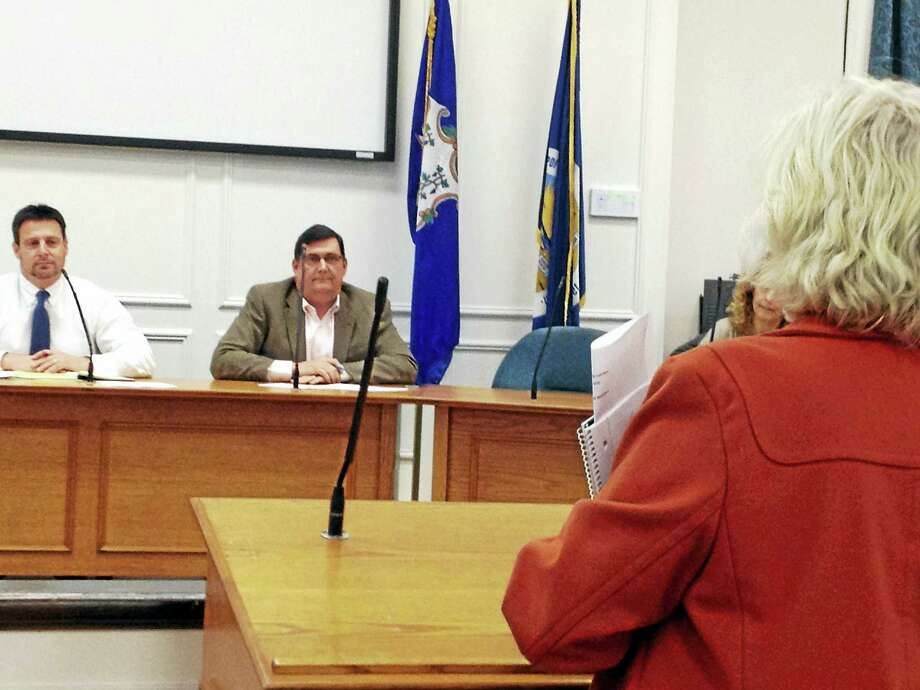 West Haven resident Carol Soter addresses the new Beach Parking Task Force Thursday night, including Chairman Ron Quagliani, left, and Mayor Ed O'Brien. Photo: MARK ZARETSKY/NEW HAVEN REGISTER