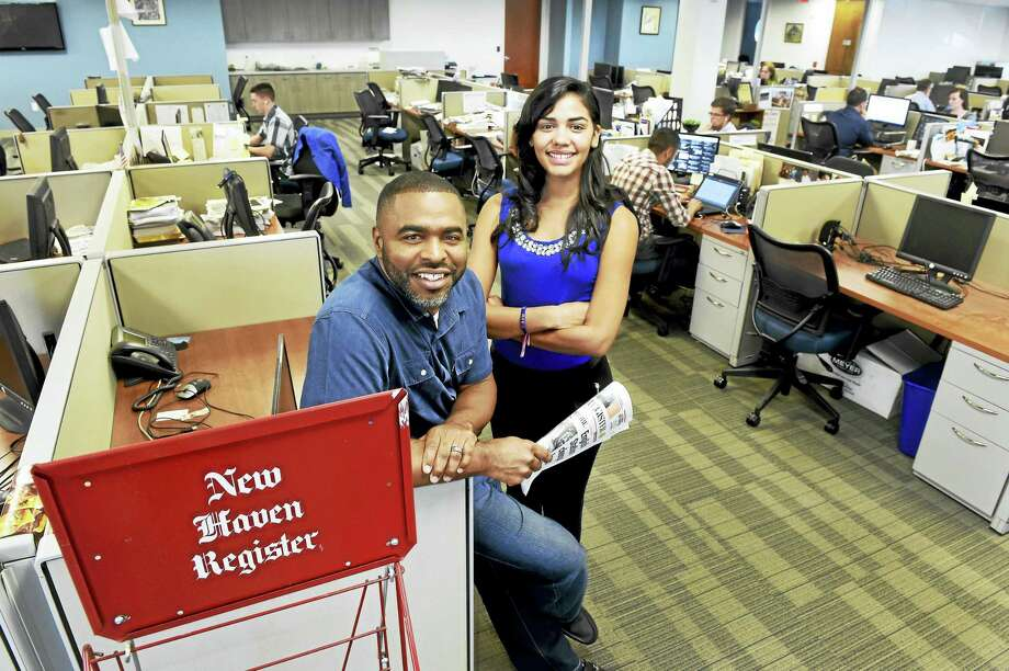 Community Engagement Editor Shahid Abdul-Karim and reporter Juliemar Ortiz of the New Haven Register are photographed in the newsroom on Sept. 18, 2015. Photo: Peter Hvizdak — New Haven Register   / ©2015 Peter Hvizdak