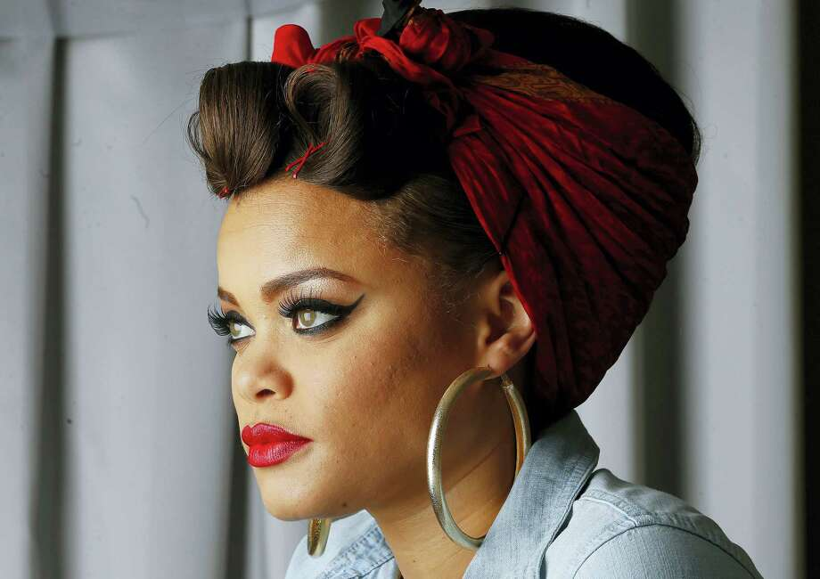 "In this Jan. 24, 2016 photo, recording artist Andra Day poses for a portrait in Atlanta. The 31-year-old soulful singer is nominated for two Grammys for Best R&B Album for her debut album ""Cheers to the Fall"" and her standout single ""Rise Up,"" which landed a nod for Best R&B performance. Photo: AP Photo/John Bazemore   / AP"