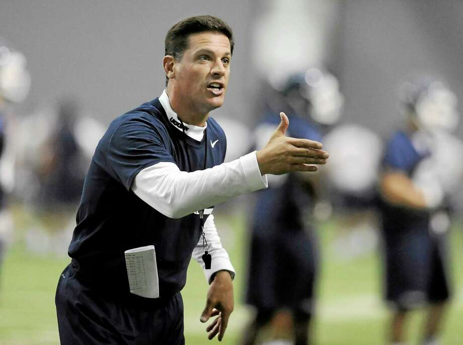 Connecticut head coach Bob Diaco gestures to his team during the first NCAA college football practice, Saturday, Aug. 2, 2014, in Storrs, Conn. (AP Photo/Jessica Hill) Photo: AP / FR125654 AP