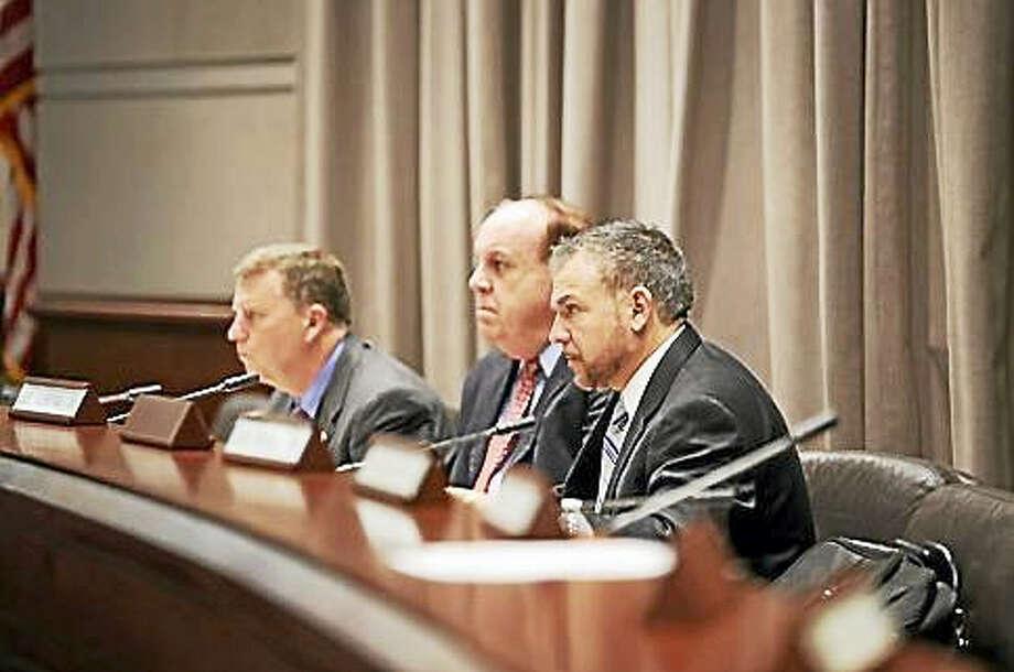 Reps. Joe Verrengia and Stephen Dargan and Sen. Tim Larson listen to the public testify. Photo: CHRISTINE STUART — CT NEWS JUNKIE