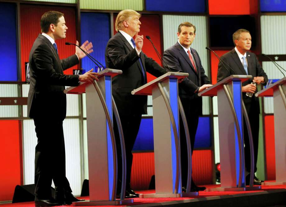 Republican presidential candidates, Sen. Marco Rubio, R-Fla., and businessman Donald Trump argue as Sen. Ted Cruz, R-Texas, and Ohio Gov. John Kasich listen during a Republican presidential primary debate at Fox Theatre, Thursday, March 3, 2016, in Detroit. Photo: AP Photo — Paul Sancya / AP