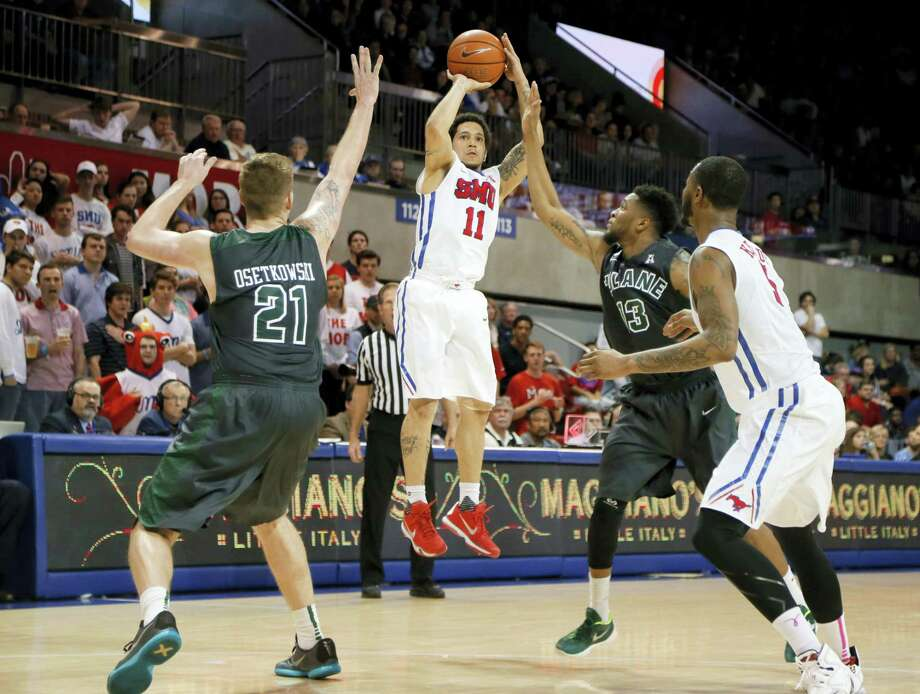 UConn will be entering an environment pumped uoup to send out SMU's Nic Moore (11) on a winning note tonight. Photo: The Associated Press   / FR171315 AP
